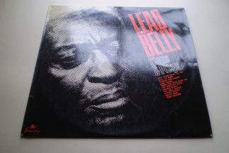 Lead Belly Plays And Sings